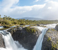 Petrohue Falls and Osorno Volcano with its snowy peak near Puerto Varas, Chile Royalty Free Stock Images