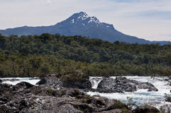 Petrohue Falls and Pontiagudo Volcano in Chile Royalty Free Stock Image