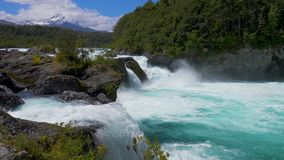 Petrohue waterfalls. With the Osorno and Calvuco volcanoes stock footage