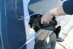Petrol. Person filling his petrol tank Royalty Free Stock Photos