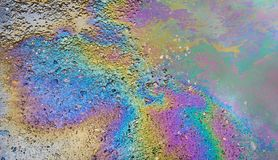 Petrol on the asphalt a big puddle water. stock photos