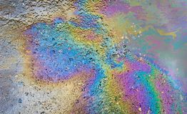 Petrol on the asphalt a big puddle water. stock photo