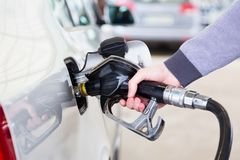 Petrol being pumped into a motor vehicle car. Stock Photography
