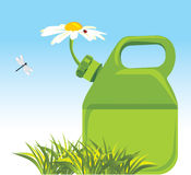 Petrol canister with chamomile. Eco concept Stock Image