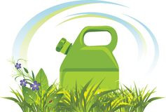 Petrol canister among grass and flowers Stock Photos