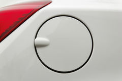 Petrol cap. A close up of a petrol cap cover on a modern white car Royalty Free Stock Photography