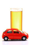 Petrol and car. Glass full of petrol with red car isolated on white background Royalty Free Stock Photos