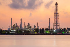 Petrol chemical refinery industry plant waterfront, dramatic sky during sunrise Stock Image