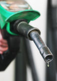 Petrol. Drop of fuel drips from petrol pistol royalty free stock image
