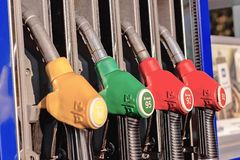 Petrol filling gun close-up at the gas station royalty free stock photos