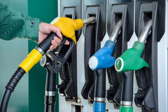 Petrol filling station. Close-up of a men's hand using a fuel nozzle at a gas station. Petrol station. Filling station. Petrol. Gasoline Royalty Free Stock Image