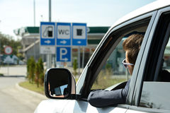 Petrol filling station. Man in his car stops at petrol station royalty free stock images