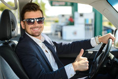 Petrol filling station. Man in his car stops at petrol station Royalty Free Stock Photography