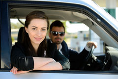 Petrol filling station. Man and women in his car stops at petrol station stock photography