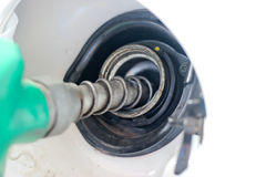 Petrol filling station. White car at gas station / Refueling hose Stock Photos