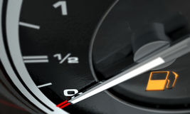 Petrol Gage Empty. A 3D render of an extreme closeup of a gas gage showing the needle at empty with an illuminated light indicating so Royalty Free Stock Photography