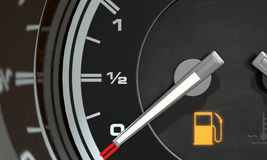 Petrol Gage Empty. A 3D render of an extreme closeup of a gas gage showing the needle at empty with an illuminated light indicating so Royalty Free Stock Image