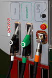 Petrol and gas. Petrol diesel and auto gas nozzles at fuel station Royalty Free Stock Photos
