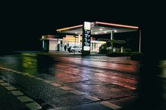 Petrol gas station station at night. With lights stock images