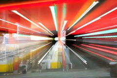 Petrol gas station with night lights. Blurred Image of Petrol gas station at night with lights on and mini-mart royalty free stock photos