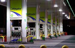 Petrol gas station with night lights. Petrol gas station at night with lights on and mini-mart. BP gas station royalty free stock images