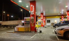 Petrol gas station with night lights. Petrol gas station at night with lights on and mini-mart. Shell gas station stock photo