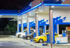 Petrol gas station in blue at night with lights. Petrol gas station at night with lights stock photo