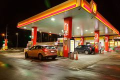 Petrol gas station with night lights. Petrol gas station at night with lights on and mini-mart. Shell gas station royalty free stock photography