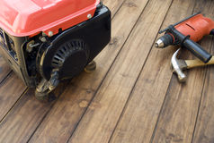 Petrol generator and tools on table Stock Photo