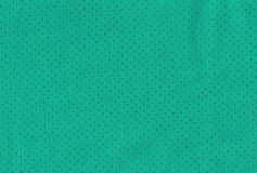 Petrol green fabric. Green coloured texture with golden dots on fabric Royalty Free Stock Image