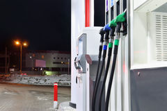 Petrol guns on refueling station Royalty Free Stock Photos