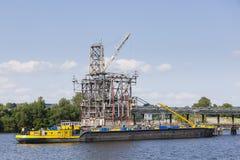 Petrol Harbor With Docked Ship. Docked ship in a petrol harbor in Hamburg Harbor, Germany Royalty Free Stock Photo