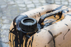 Petrol jerry can. Focus on old jerry can dirty of black petrol Stock Photo