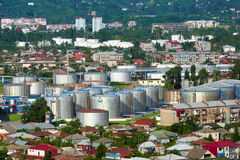 Petrol and oil tanks. Chemical storage located inside small town stock photos