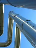 Petrol pipelines on blue sky. Petrol steel pipelines on blue sky Royalty Free Stock Photography