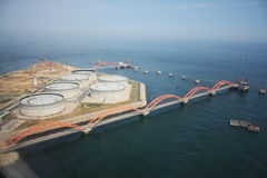 Petrol port and energy storage by sea Royalty Free Stock Photography