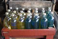 Petrol is presented for sale in vodka bottles in a street of Jakarta, Indonesia.  stock image