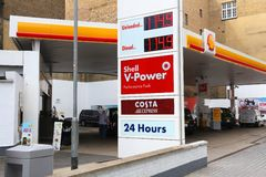 Petrol prices London. LONDON, UK - JULY 9, 2016: Petrol prices at Shell gas station in London. Royal Dutch Shell is a large multinational oil company royalty free stock image