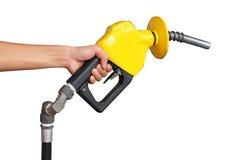 Petrol Pump. Holding A Yellow Petrol Pump Stock Photography