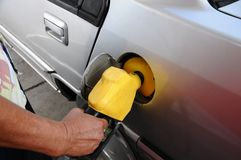 Petrol Pump. An image of an car fueling up with petrol at a petrol station Stock Photography