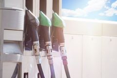 Petrol pump against a blue and cloudy sky. Gasoline and oil price concept. Empty copy space. For Editor`s text Royalty Free Stock Image