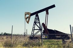 Petrol pump in a field Fuel extraction. Oil extraction Selective focus stock photo