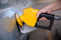 Petrol pump filling. Close up of Petrol pump filling royalty free stock photo