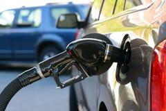 Petrol pump filling. Close up of gas filling at petrol station stock photo