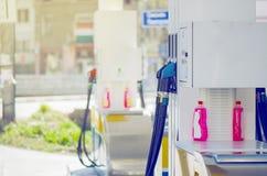 Petrol Pump Filling Nozzles. Colorful Petrol Pump Filling Nozzles. Gas station in a service in warm sunset royalty free stock image