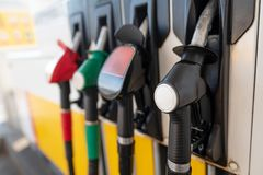 Petrol pump filling nozzles. Fuel at gas station close up royalty free stock image