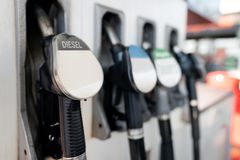 Petrol pump filling nozzles. Fuel at gas station close up stock photo