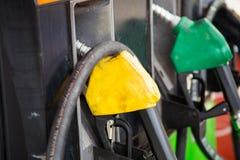 Petrol pump filling yello Royalty Free Stock Photo