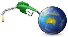 A petrol pump and a globe Stock Photos