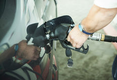 Petrol pump in hand royalty free stock photo